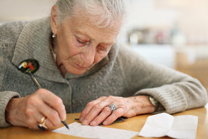Senior lady writing